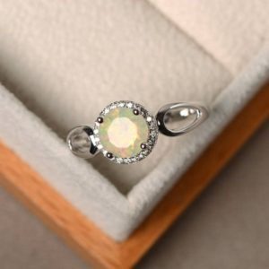 Shop Opal Rings! Halo rings, opal engagement rings, natural opal rings, round cut rings, sterling silver rings, October birthstone | Natural genuine Opal rings, simple unique alternative gemstone engagement rings. #rings #jewelry #bridal #wedding #jewelryaccessories #engagementrings #weddingideas #affiliate #ad