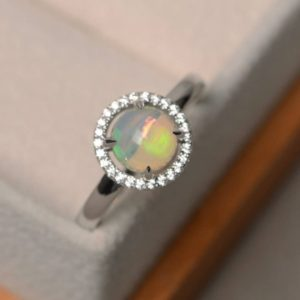 Shop Opal Rings! Natural white opal rings, unique wedding rings, October birthstone, round cut rings, Christmas gifts | Natural genuine Opal rings, simple unique alternative gemstone engagement rings. #rings #jewelry #bridal #wedding #jewelryaccessories #engagementrings #weddingideas #affiliate #ad
