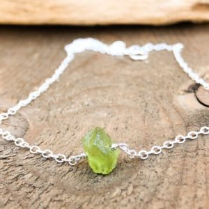 Shop Peridot Pendants! August Birthstone – Raw Peridot Jewelry – Peridot Pendant – Raw Green Peridot – Peridot Necklace – Raw Peridot – Birthstone Necklace | Natural genuine Peridot pendants. Buy crystal jewelry, handmade handcrafted artisan jewelry for women.  Unique handmade gift ideas. #jewelry #beadedpendants #beadedjewelry #gift #shopping #handmadejewelry #fashion #style #product #pendants #affiliate #ad