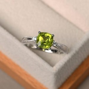 Natural peridot ring, sterling silver, cushion cut, engagement ring for women, August birthstone ring | Natural genuine Gemstone rings, simple unique alternative gemstone engagement rings. #rings #jewelry #bridal #wedding #jewelryaccessories #engagementrings #weddingideas #affiliate #ad