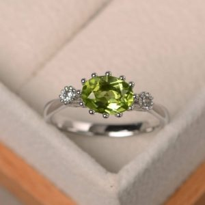 August birthstone, natural peridot ring, engagement ring, green gemstone, oval cut gemstone | Natural genuine Gemstone rings, simple unique alternative gemstone engagement rings. #rings #jewelry #bridal #wedding #jewelryaccessories #engagementrings #weddingideas #affiliate #ad