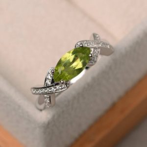 Engagement ring, natural peridot ring, August birthstone, marquise cut green gemstone, sterling silver ring | Natural genuine Gemstone rings, simple unique alternative gemstone engagement rings. #rings #jewelry #bridal #wedding #jewelryaccessories #engagementrings #weddingideas #affiliate #ad