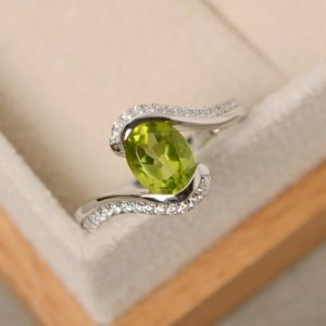 Shop Peridot Rings! Green peridot ring, oval cut, sterling silver, green gemstone ring, oval peridot ring | Natural genuine Peridot rings, simple unique handcrafted gemstone rings. #rings #jewelry #shopping #gift #handmade #fashion #style #affiliate #ad
