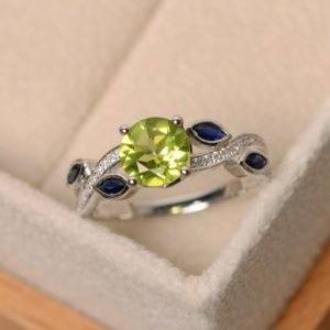 Shop Peridot Rings! Natural peridot ring, leaf ring, peridot engagement ring, sterling silver | Natural genuine Peridot rings, simple unique alternative gemstone engagement rings. #rings #jewelry #bridal #wedding #jewelryaccessories #engagementrings #weddingideas #affiliate #ad