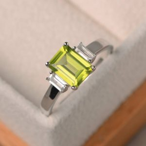 Shop Peridot Rings! Natural peridot ring, promise ring, emerald cut green gemstone, August birthstone, sterling silver ring | Natural genuine Peridot rings, simple unique handcrafted gemstone rings. #rings #jewelry #shopping #gift #handmade #fashion #style #affiliate #ad
