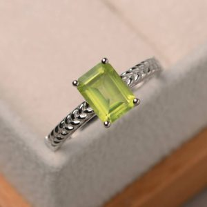 Shop Peridot Rings! Natural peridot ring, wedding ring, emerald cut green gemstone, August birthstone, sterling silver ring | Natural genuine Peridot rings, simple unique alternative gemstone engagement rings. #rings #jewelry #bridal #wedding #jewelryaccessories #engagementrings #weddingideas #affiliate #ad