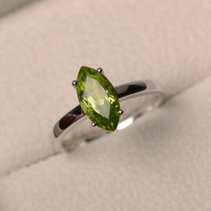 Shop Peridot Rings! Natural peridot ring, wedding ring, green gemstone, solitaire ring, marquise cut gemstone, August birthstone | Natural genuine Peridot rings, simple unique alternative gemstone engagement rings. #rings #jewelry #bridal #wedding #jewelryaccessories #engagementrings #weddingideas #affiliate #ad