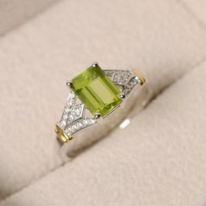 Shop Peridot Rings! Natural peridot ring, yellow gold, emerald cut, green perisot, wedding ring | Natural genuine Peridot rings, simple unique alternative gemstone engagement rings. #rings #jewelry #bridal #wedding #jewelryaccessories #engagementrings #weddingideas #affiliate #ad