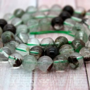Shop Quartz Crystal Round Beads! Green Phantom Round Quartz Clear Gemstone Beads (4mm 6mm 8mm 10mm) | Natural genuine round Quartz beads for beading and jewelry making.  #jewelry #beads #beadedjewelry #diyjewelry #jewelrymaking #beadstore #beading #affiliate #ad