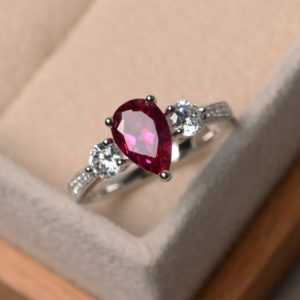 July birthstone ring, lab red ruby ring, engagement ring, pear cut ruby, gemstone ring, sterling silver ring, three stones ring | Natural genuine Array rings, simple unique alternative gemstone engagement rings. #rings #jewelry #bridal #wedding #jewelryaccessories #engagementrings #weddingideas #affiliate #ad