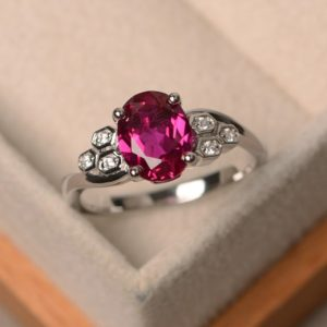Lab ruby ring, oval cut gemstone, sterling silver ring, engagement ring | Natural genuine Ruby rings, simple unique alternative gemstone engagement rings. #rings #jewelry #bridal #wedding #jewelryaccessories #engagementrings #weddingideas #affiliate #ad