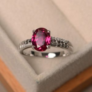 Lab ruby ring, oval cut gemstone, sterling silver ring, engagement ring | Natural genuine Array rings, simple unique alternative gemstone engagement rings. #rings #jewelry #bridal #wedding #jewelryaccessories #engagementrings #weddingideas #affiliate #ad