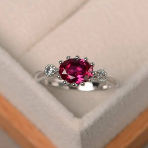 Shop Ruby Rings! Lab ruby ring, wedding ring, red gemstone, oval cut gemstone, July birthstone, three stones ring | Natural genuine Ruby rings, simple unique alternative gemstone engagement rings. #rings #jewelry #bridal #wedding #jewelryaccessories #engagementrings #weddingideas #affiliate #ad