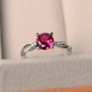 Shop Ruby Rings! Ruby promise rings, July birthstone rings, round cut red stone, sterling silver rings, wedding gifts | Natural genuine Ruby rings, simple unique alternative gemstone engagement rings. #rings #jewelry #bridal #wedding #jewelryaccessories #engagementrings #weddingideas #affiliate #ad