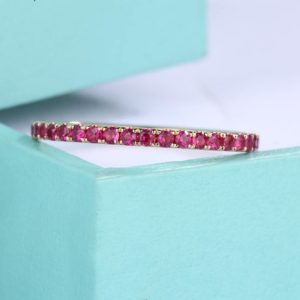 Shop Ruby Rings! Rose gold Ruby Wedding Band Eternity ring Minimalism simple women stacking matching Birthstone Pave Anniversary Everyday rings gift for her | Natural genuine Ruby rings, simple unique alternative gemstone engagement rings. #rings #jewelry #bridal #wedding #jewelryaccessories #engagementrings #weddingideas #affiliate #ad