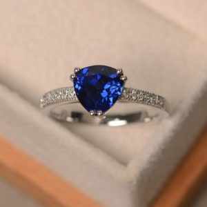 Shop Unique Sapphire Engagement Rings! Blue sapphire ring, engagement ring, trillion cut gemstone, September birthstone, sterling silver ring | Natural genuine Sapphire rings, simple unique alternative gemstone engagement rings. #rings #jewelry #bridal #wedding #jewelryaccessories #engagementrings #weddingideas #affiliate #ad