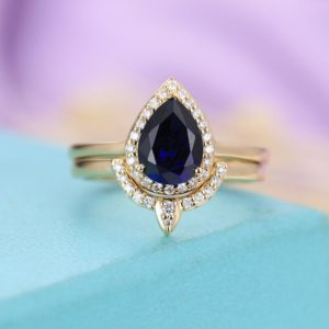 Shop Sapphire Rings! Sapphire Engagement Ring Pear Shaped Engagement Ring Women Vintage Wedding Antique Unique Halo Diamond Bridal Set Jewelry Anniversary Gift | Natural genuine Sapphire rings, simple unique alternative gemstone engagement rings. #rings #jewelry #bridal #wedding #jewelryaccessories #engagementrings #weddingideas #affiliate #ad