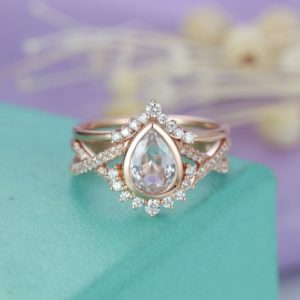 Shop Sapphire Rings! White Topaz engagement ring Rose gold Diamond/Moissanite wedding band Women Vintage Pear shaped Twisted Bridal Jewelry Anniversary Gift | Natural genuine Sapphire rings, simple unique alternative gemstone engagement rings. #rings #jewelry #bridal #wedding #jewelryaccessories #engagementrings #weddingideas #affiliate #ad