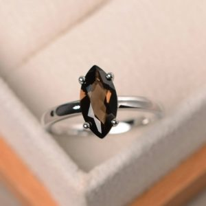 Shop Smoky Quartz Rings! Cocktail party ring, natural smoky quartz ring, brown gemstone, solitaire ring, marquise cut gemstone | Natural genuine Smoky Quartz rings, simple unique handcrafted gemstone rings. #rings #jewelry #shopping #gift #handmade #fashion #style #affiliate #ad