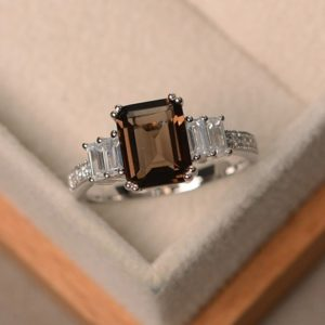 Shop Smoky Quartz Rings! Natural smoky quartz ring, emerald cut engagement ring, gemstone ring silver, promise ring | Natural genuine Smoky Quartz rings, simple unique alternative gemstone engagement rings. #rings #jewelry #bridal #wedding #jewelryaccessories #engagementrings #weddingideas #affiliate #ad