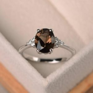 Oval smoky quartz ring, 14k gold filled ring, oval shaped engagement ring, brown stone ring | Natural genuine Gemstone rings, simple unique alternative gemstone engagement rings. #rings #jewelry #bridal #wedding #jewelryaccessories #engagementrings #weddingideas #affiliate #ad