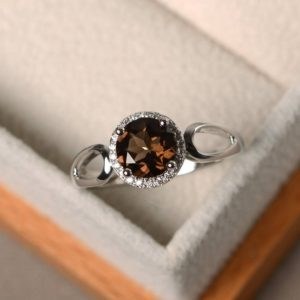 Shop Smoky Quartz Rings! Wedding rings, natural smoky quartz rings, round cut rings, silver rings, halo rings,unique rings | Natural genuine Smoky Quartz rings, simple unique alternative gemstone engagement rings. #rings #jewelry #bridal #wedding #jewelryaccessories #engagementrings #weddingideas #affiliate #ad