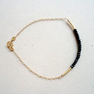 Shop Spinel Bracelets! Black Spinel Bracelet Gold Chain Bead Bar Thin Chain Skinny Bracelet Black and Gold TBM | Natural genuine Spinel bracelets. Buy crystal jewelry, handmade handcrafted artisan jewelry for women.  Unique handmade gift ideas. #jewelry #beadedbracelets #beadedjewelry #gift #shopping #handmadejewelry #fashion #style #product #bracelets #affiliate #ad