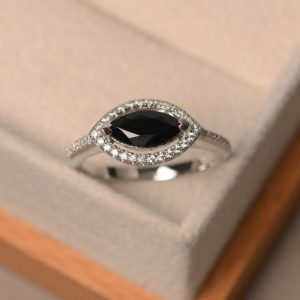 Shop Spinel Rings! Natural black spinel ring, marquise cut gemstone, sterling silver, engagement ring, black gemstone, engagement ring | Natural genuine Spinel rings, simple unique alternative gemstone engagement rings. #rings #jewelry #bridal #wedding #jewelryaccessories #engagementrings #weddingideas #affiliate #ad