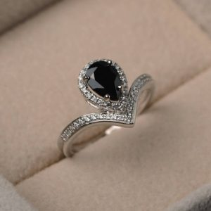 Shop Spinel Jewelry! Natural black spinel ring, pear cut gemstone, sterling silver, engagement ring, black gemstone, bridal ring | Natural genuine Spinel jewelry. Buy handcrafted artisan wedding jewelry.  Unique handmade bridal jewelry gift ideas. #jewelry #beadedjewelry #gift #crystaljewelry #shopping #handmadejewelry #wedding #bridal #jewelry #affiliate #ad