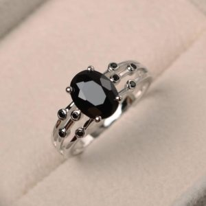 Shop Spinel Rings! Natural Black Spinel Ring, Promise Ring, Oval Cut Black Gemstone, Sterling Silver Ring | Natural genuine Spinel rings, simple unique handcrafted gemstone rings. #rings #jewelry #shopping #gift #handmade #fashion #style #affiliate #ad
