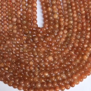 Shop Sunstone Round Beads! 15 Inches Sunstone Round 8mm Beads, sunstone Plain Round Beads | Natural genuine round Sunstone beads for beading and jewelry making.  #jewelry #beads #beadedjewelry #diyjewelry #jewelrymaking #beadstore #beading #affiliate #ad