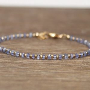 Tanzanite Bracelet, Gold Filled Beads, Tanzanite Jewelry, Minimalist, Layering, Gemstone Jewelry | Natural genuine Tanzanite bracelets. Buy crystal jewelry, handmade handcrafted artisan jewelry for women.  Unique handmade gift ideas. #jewelry #beadedbracelets #beadedjewelry #gift #shopping #handmadejewelry #fashion #style #product #bracelets #affiliate #ad