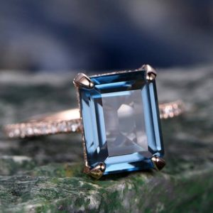 London Blue Topaz Engagement Ring 14k Rose Gold Diamond Halo Basket Infinity Ring Emerald Cut Unique Antique Wedding Promise Ring For Her | Natural genuine Gemstone rings, simple unique alternative gemstone engagement rings. #rings #jewelry #bridal #wedding #jewelryaccessories #engagementrings #weddingideas #affiliate #ad