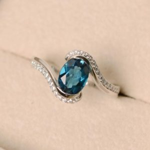 Shop Topaz Rings! London blue topaz ring, oval cut ring, engagement ring, sterling silver | Natural genuine Topaz rings, simple unique alternative gemstone engagement rings. #rings #jewelry #bridal #wedding #jewelryaccessories #engagementrings #weddingideas #affiliate #ad