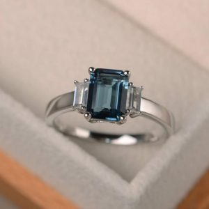 Shop Topaz Rings! London blue topaz ring, promise ring, emerald cut blue gemstone, November birthstone, sterling silver ring | Natural genuine Topaz rings, simple unique handcrafted gemstone rings. #rings #jewelry #shopping #gift #handmade #fashion #style #affiliate #ad