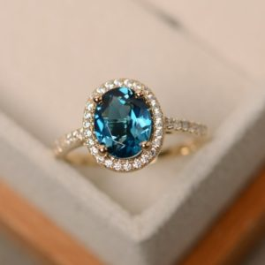Shop Topaz Jewelry! London blue topaz ring, yellow gold ring, halo engagement ring, 14k gold | Natural genuine gemstone jewelry in modern, chic, boho, elegant styles. Buy crystal handmade handcrafted artisan art jewelry & accessories. #jewelry #beaded #beadedjewelry #product #gifts #shopping #style #fashion #product