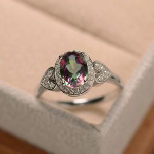 Mystic topaz ring, oval engagement ring, sterling sivler | Natural genuine Gemstone rings, simple unique alternative gemstone engagement rings. #rings #jewelry #bridal #wedding #jewelryaccessories #engagementrings #weddingideas #affiliate #ad