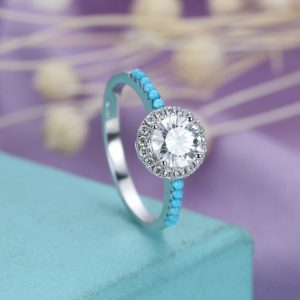 Shop Turquoise Rings! Moissanite engagement ring White gold Women Wedding Halo Diamond Turquoise Half eternity Micro pave Unique Jewelry Anniversary gift for her | Natural genuine Turquoise rings, simple unique alternative gemstone engagement rings. #rings #jewelry #bridal #wedding #jewelryaccessories #engagementrings #weddingideas #affiliate #ad
