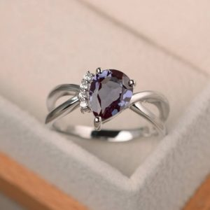 Shop Alexandrite Rings! Alexandrite Ring, Engagement Ring, Pear Cut Ring, Color Changing Gemstone, June Birthstone, Sterling Silver Ring | Natural genuine Alexandrite rings, simple unique alternative gemstone engagement rings. #rings #jewelry #bridal #wedding #jewelryaccessories #engagementrings #weddingideas #affiliate #ad