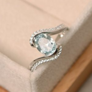 Shop Aquamarine Rings! Aquamarine Ring, aquamarine,engagement ring, March birthstone ring, oval cut aquamarine | Natural genuine Aquamarine rings, simple unique alternative gemstone engagement rings. #rings #jewelry #bridal #wedding #jewelryaccessories #engagementrings #weddingideas #affiliate #ad