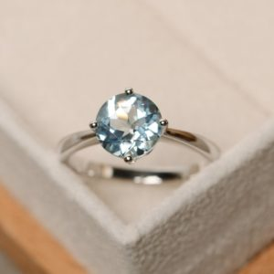 Shop Aquamarine Rings! Genuine aquamarine ring, solitaire ring, round cut, sterling silver | Natural genuine Aquamarine rings, simple unique handcrafted gemstone rings. #rings #jewelry #shopping #gift #handmade #fashion #style #affiliate #ad