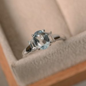 Shop Aquamarine Rings! Aquamarine ring, oval cut, three stone, March birthstone, anniversary ring | Natural genuine Aquamarine rings, simple unique handcrafted gemstone rings. #rings #jewelry #shopping #gift #handmade #fashion #style #affiliate #ad