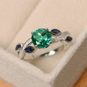 Shop Emerald Engagement Rings! Emerald ring, green emerald ring, multistone ring, leaf ring, sterling silver, ring emerald, emerald engagement ring | Natural genuine Emerald rings, simple unique alternative gemstone engagement rings. #rings #jewelry #bridal #wedding #jewelryaccessories #engagementrings #weddingideas #affiliate #ad