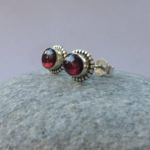 Shop Garnet Earrings! Garnet stud earrings, natural Garnet sterling studs, Red gem stud earrings, Garnet oval studs, button earrings, silver studs, gift for her | Natural genuine Garnet earrings. Buy crystal jewelry, handmade handcrafted artisan jewelry for women.  Unique handmade gift ideas. #jewelry #beadedearrings #beadedjewelry #gift #shopping #handmadejewelry #fashion #style #product #earrings #affiliate #ad