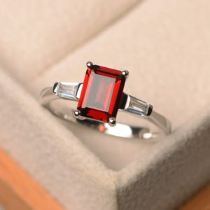 Shop Garnet Rings! Natural garnet ring, promise ring, emerald cut red gemstone, sterling silver ring, January birthstone | Natural genuine Garnet rings, simple unique handcrafted gemstone rings. #rings #jewelry #shopping #gift #handmade #fashion #style #affiliate #ad