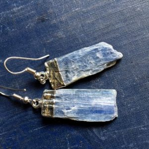 Shop Kyanite Jewelry! Kyanite Silver Earrings,Kyanite Earrings Silver,Raw Gemstone Earrings Silver,Silver Edged Raw Stone earrings,Kyanite Blue Gemstone Earrings | Natural genuine Kyanite jewelry. Buy crystal jewelry, handmade handcrafted artisan jewelry for women.  Unique handmade gift ideas. #jewelry #beadedjewelry #beadedjewelry #gift #shopping #handmadejewelry #fashion #style #product #jewelry #affiliate #ad