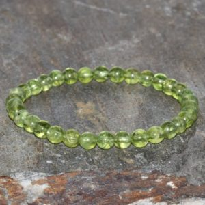 Shop Peridot Bracelets! Dainty Peridot Bracelet Handmade 5mm-5.5mm Peridot Beaded Gemstone Bracelet Green Olivine Bracelet Stack Bracelet Unisex Gift Bracelet | Natural genuine Peridot bracelets. Buy crystal jewelry, handmade handcrafted artisan jewelry for women.  Unique handmade gift ideas. #jewelry #beadedbracelets #beadedjewelry #gift #shopping #handmadejewelry #fashion #style #product #bracelets #affiliate #ad
