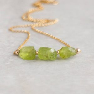 Shop Peridot Necklaces! Raw Peridot Necklace, 3 Wishes Necklace, Raw Crystal Jewelry, August Birthstone Gift For Her | Natural genuine Peridot necklaces. Buy crystal jewelry, handmade handcrafted artisan jewelry for women.  Unique handmade gift ideas. #jewelry #beadednecklaces #beadedjewelry #gift #shopping #handmadejewelry #fashion #style #product #necklaces #affiliate #ad