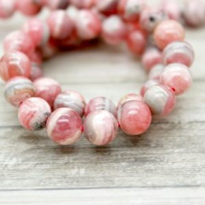Shop Rhodochrosite Beads! Natural Rhodochrosite Smooth Round Sphere Ball Loose Gemstone Beads – Full Strand (6mm 7mm 8mm 9mm 10mm) | Natural genuine beads Rhodochrosite beads for beading and jewelry making.  #jewelry #beads #beadedjewelry #diyjewelry #jewelrymaking #beadstore #beading #affiliate #ad