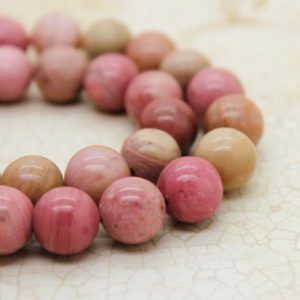 Shop Rhodonite Round Beads! Rhodonite High Quality Smooth Round Natural Gemstone Beads (4mm 6mm 8mm 10mm) | Natural genuine round Rhodonite beads for beading and jewelry making.  #jewelry #beads #beadedjewelry #diyjewelry #jewelrymaking #beadstore #beading #affiliate